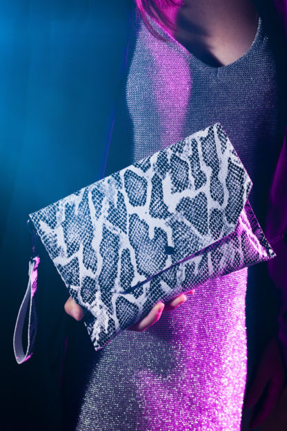snake print leather clutch bag